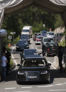 Car pass a checkpoint on a road leading to the Interalpen-Hotel Tirol, venue of the Bilderberg conference, on June 11, 2015 near Telfs, Austria. The Bilderberg group, which brings together international leaders from politics, high finance, business and academia begins its highly exclusive annual meeting in a luxury hotel in the Austrian Alps. AFP PHOTO / CHRISTIAN BRUNA